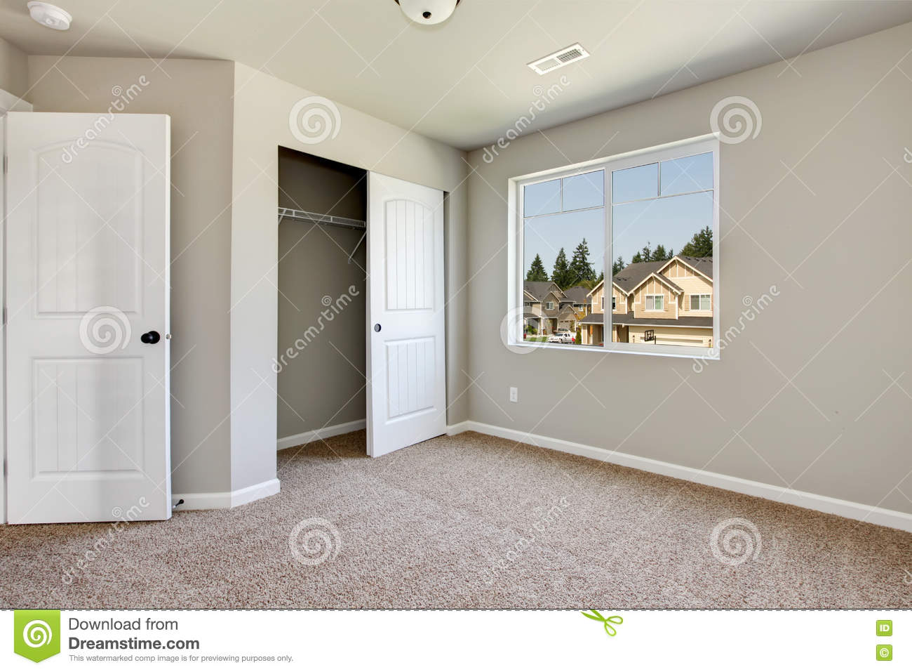 Small Empty Room With Window And Carpet Floor Stock