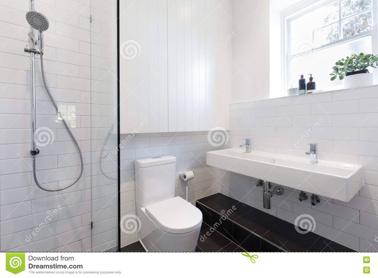 Small Ensuite Bathroom With White Tiling Laid In A Brick Pattern