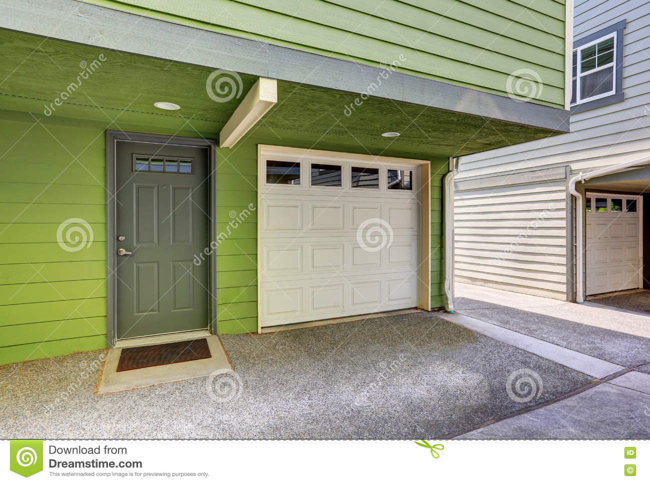 Small Entrance Porch And Garage Door Of Duplex House. Small Entrance Porch  And Garage Door