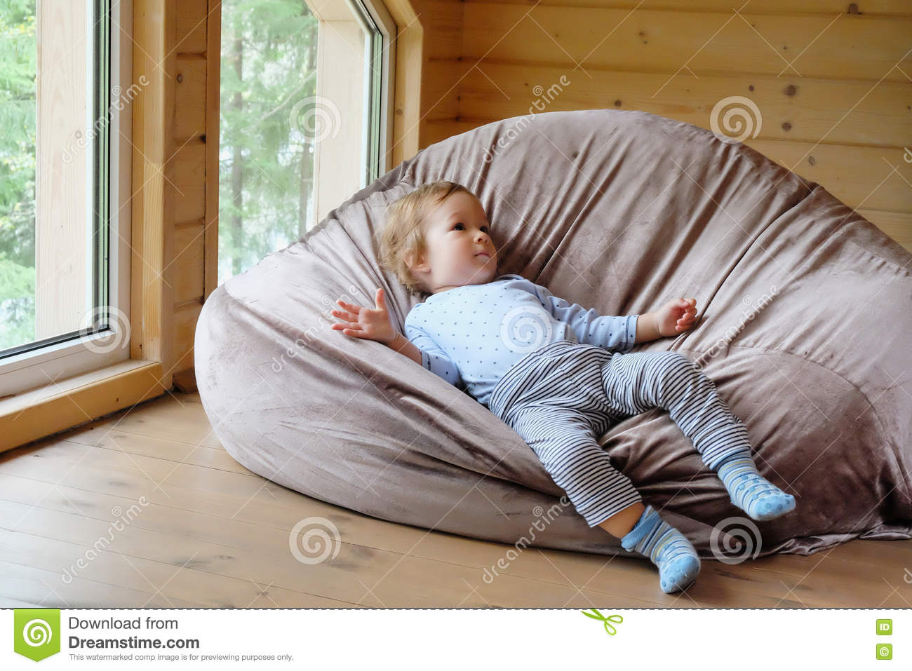 Fabulous Small European Boy Lies On A Bean Bag Stock Image Image Of Caraccident5 Cool Chair Designs And Ideas Caraccident5Info
