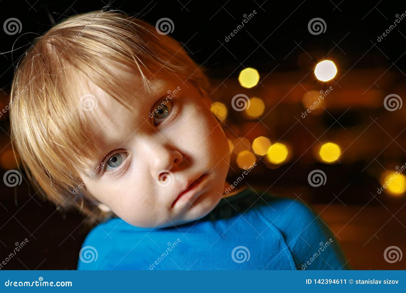 Small fair hair toddler boy in airplane