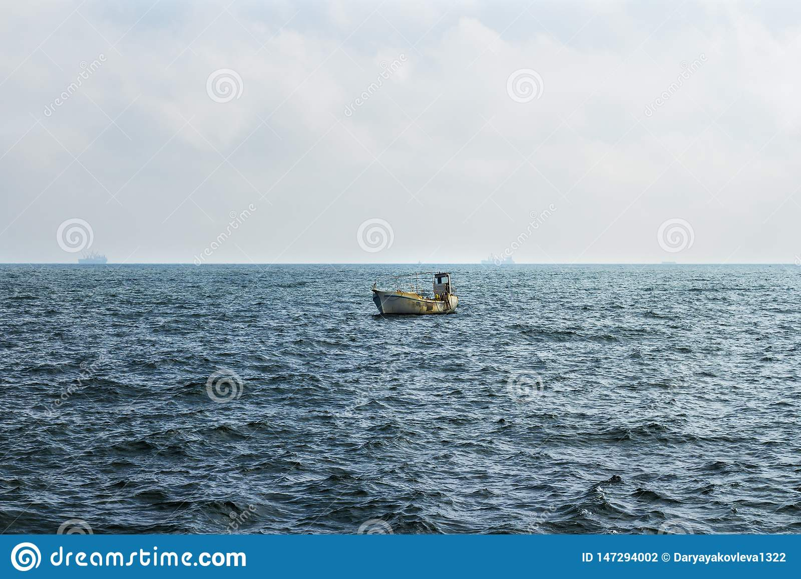 Small Fisher Boat Drifting In The Black Sea Stock Photo