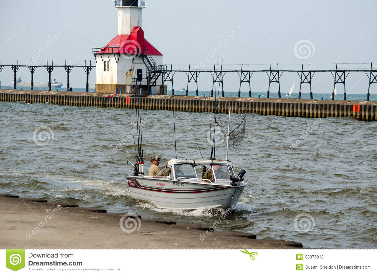 Fishing boat and light house editorial stock image image for St joseph michigan fishing report