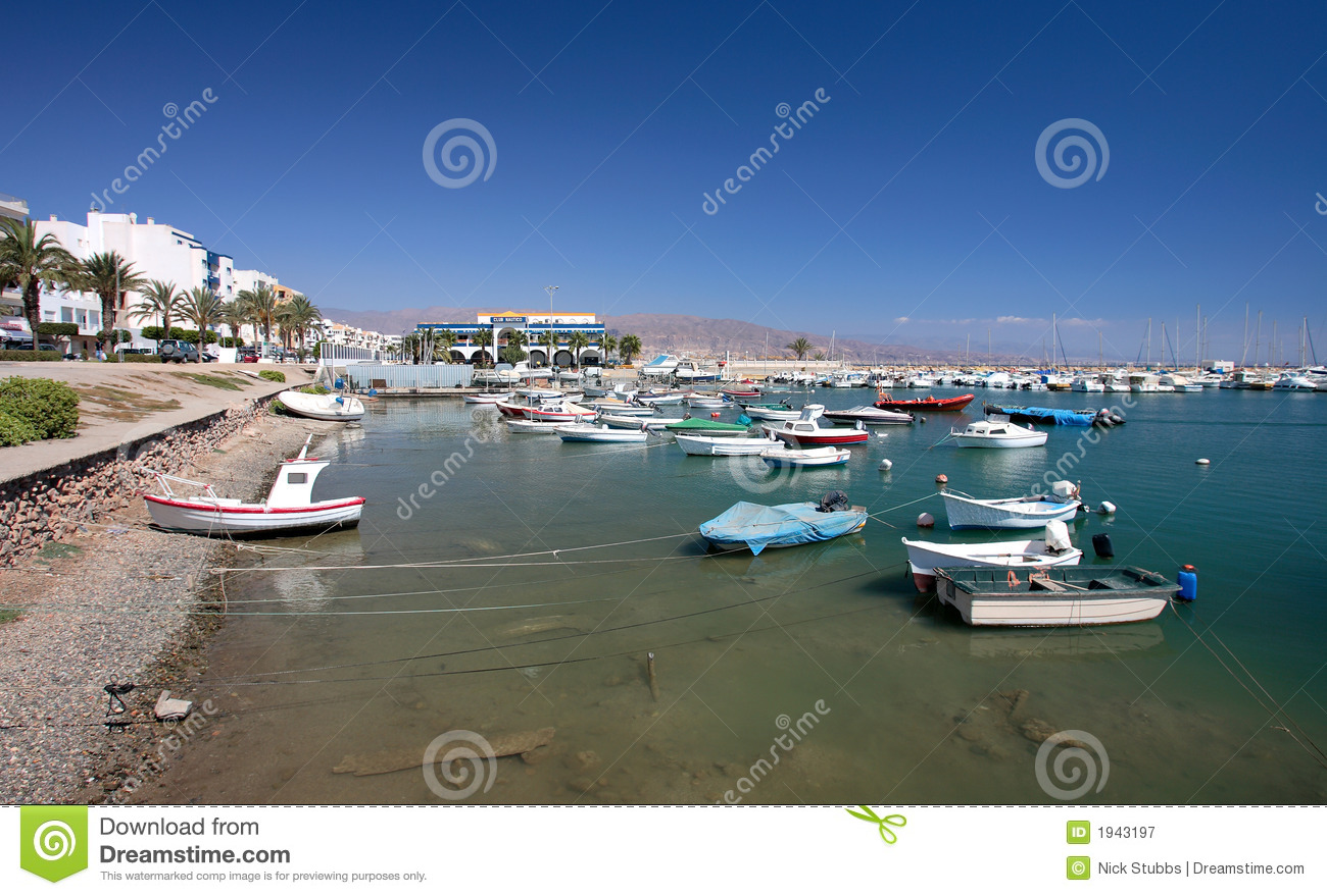 Small fishing boats and yachts moored in Roquets del Mar port or