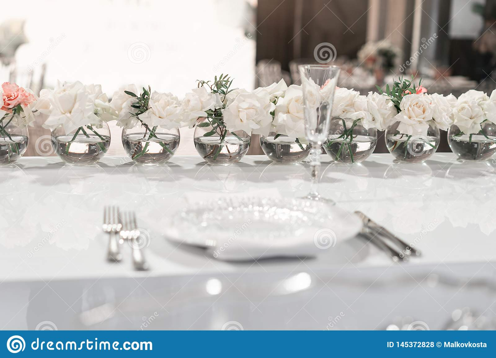 Small Flower Arrangements In Ball Glass Vases The Table Of The Newlyweds Interior Of Restaurant For Wedding Dinner Stock Photo Image Of Elegant Flower 145372828