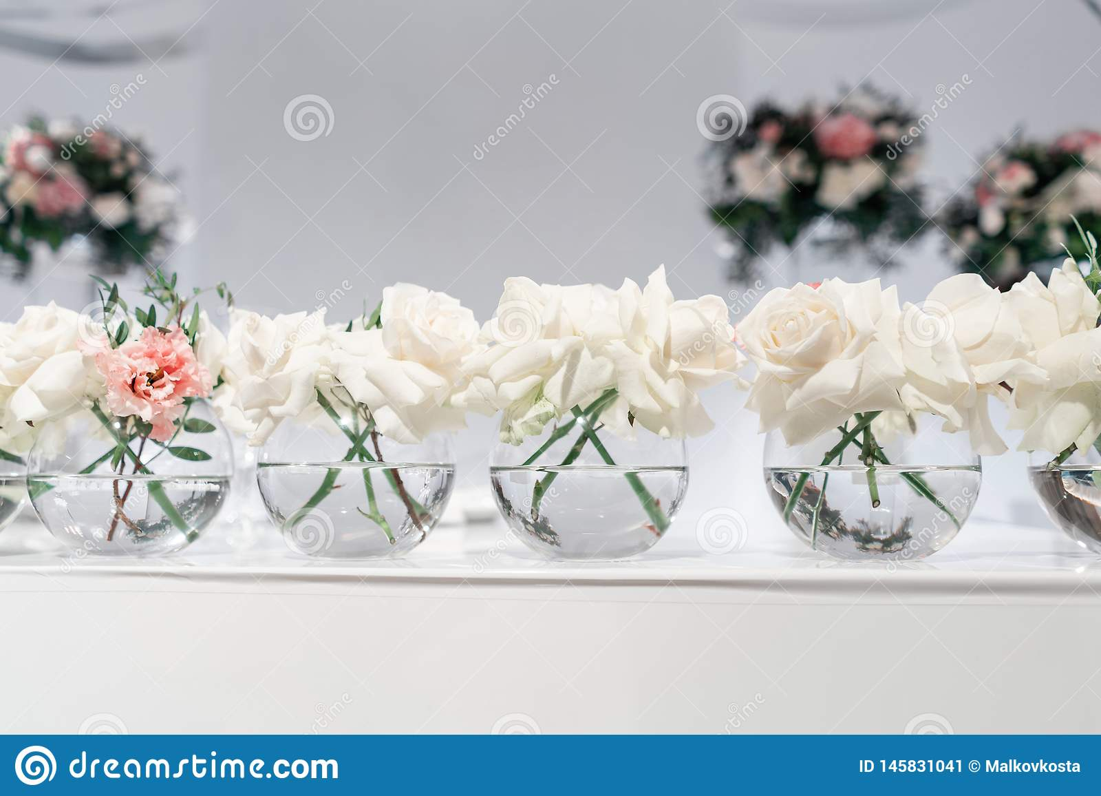 Small Flower Arrangements In Ball Glass Vases The Table Of The