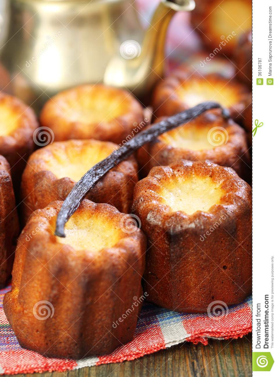 Small French Cakes Canele And Vanilla