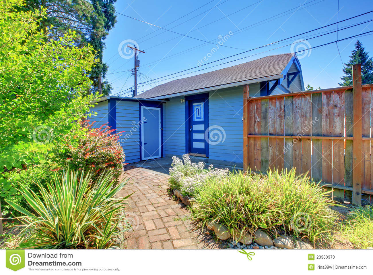 Small garage in back yard with fence stock photos image for Garage fence