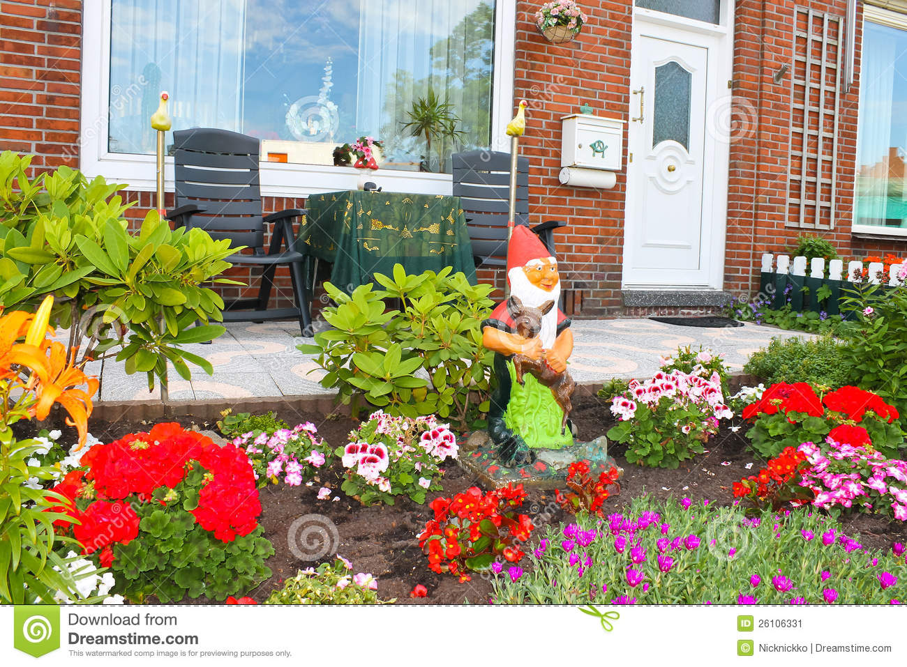 Small garden in front of the dutch house stock image for Small flower garden in front of house