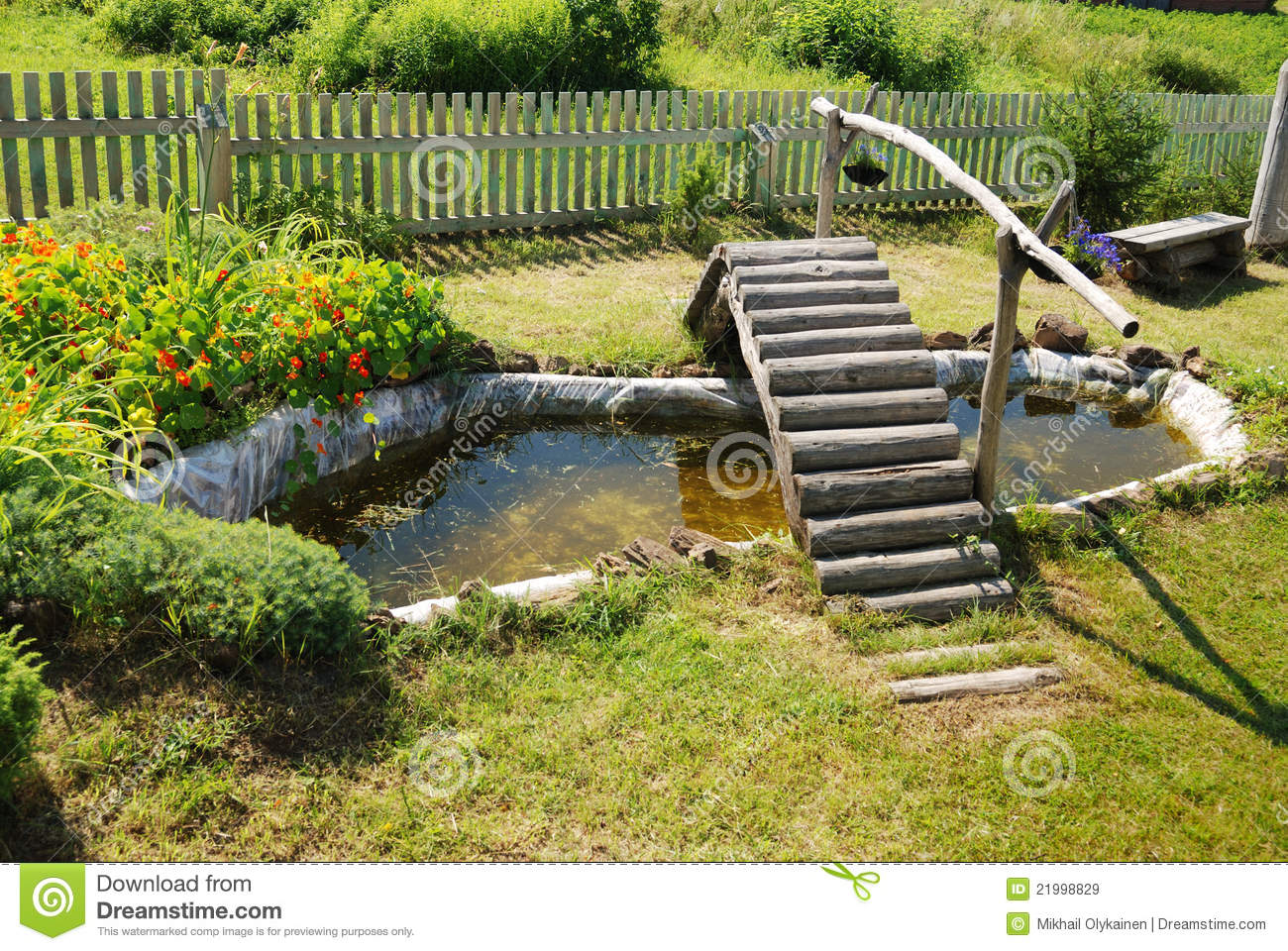 Small garden pond with wooden bridge stock image image for Fish pond bridges
