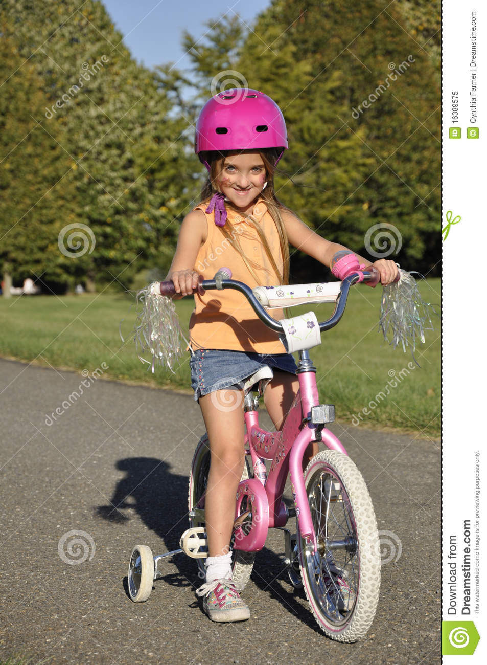 Bikes With Training Wheels For Girls Small girl on a bike with