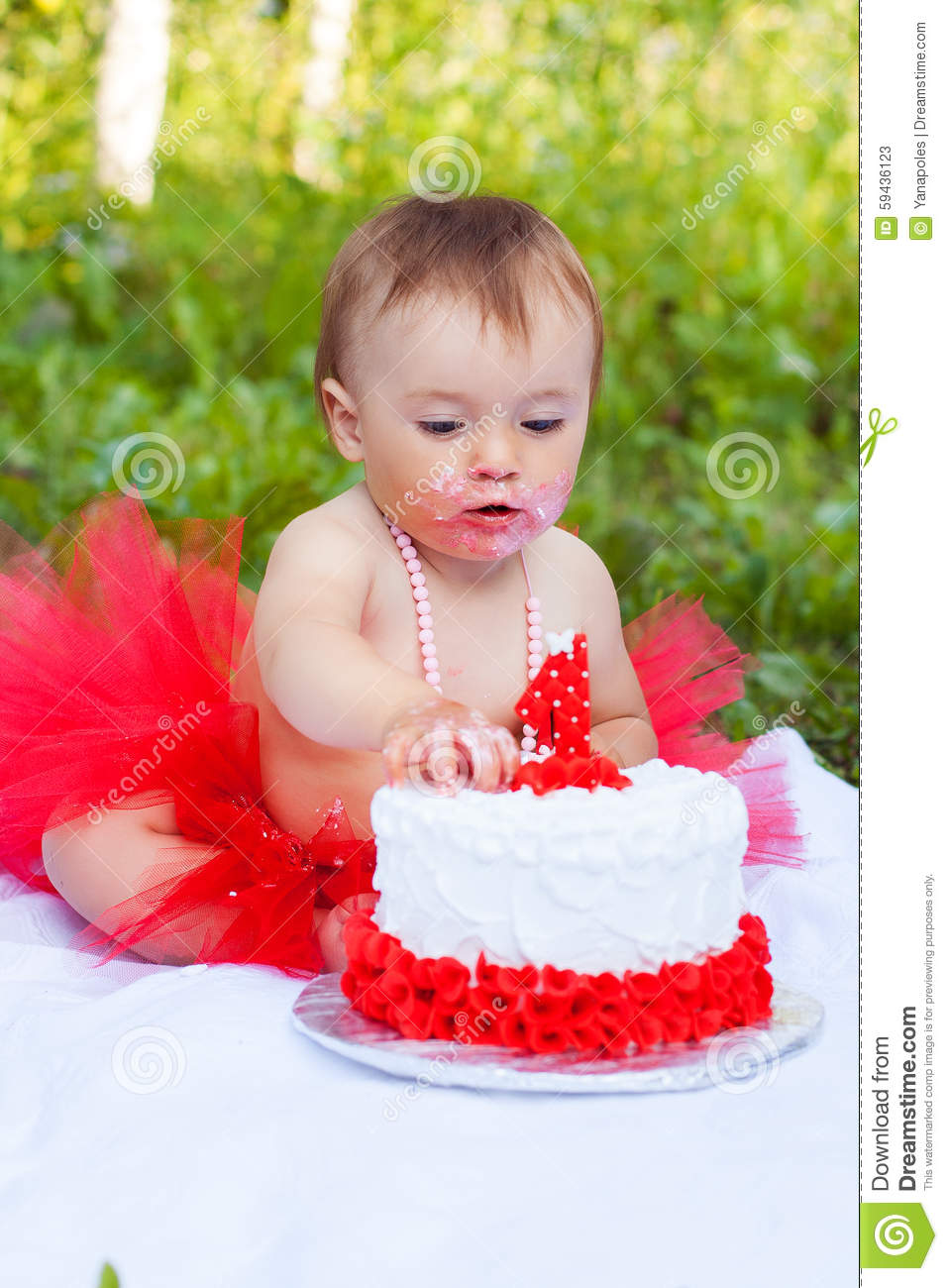 Small Girl Eating Her First Birthday Cake Stock Photo Image - Small first birthday cakes