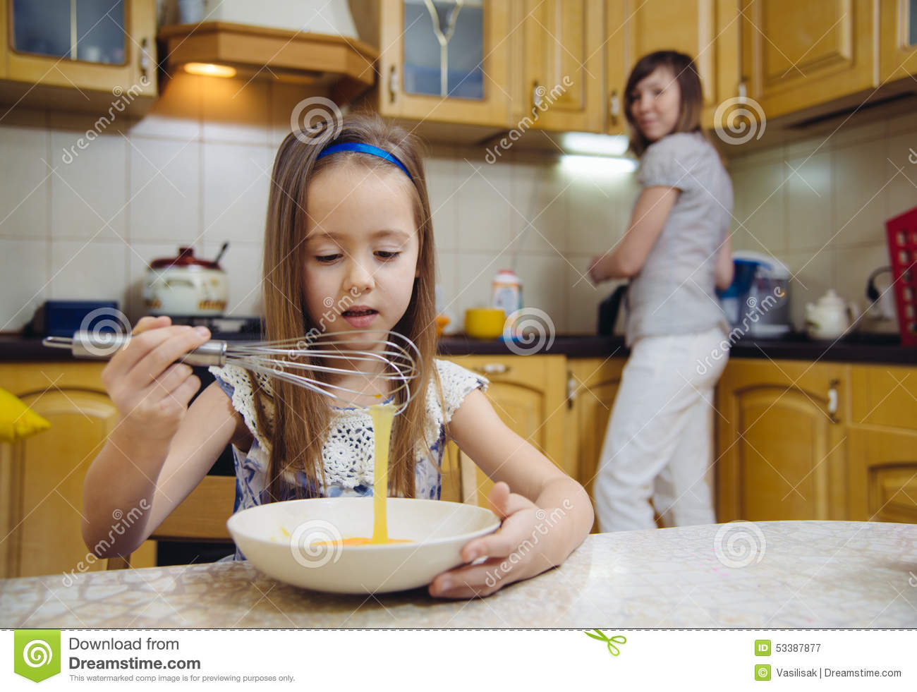 small girl going to beat the dough for pancakes stock photo image 53387877