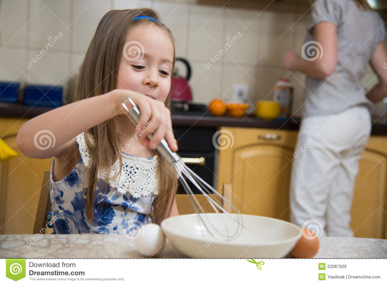 small girl going to beat the dough for pancakes stock image image 53387939