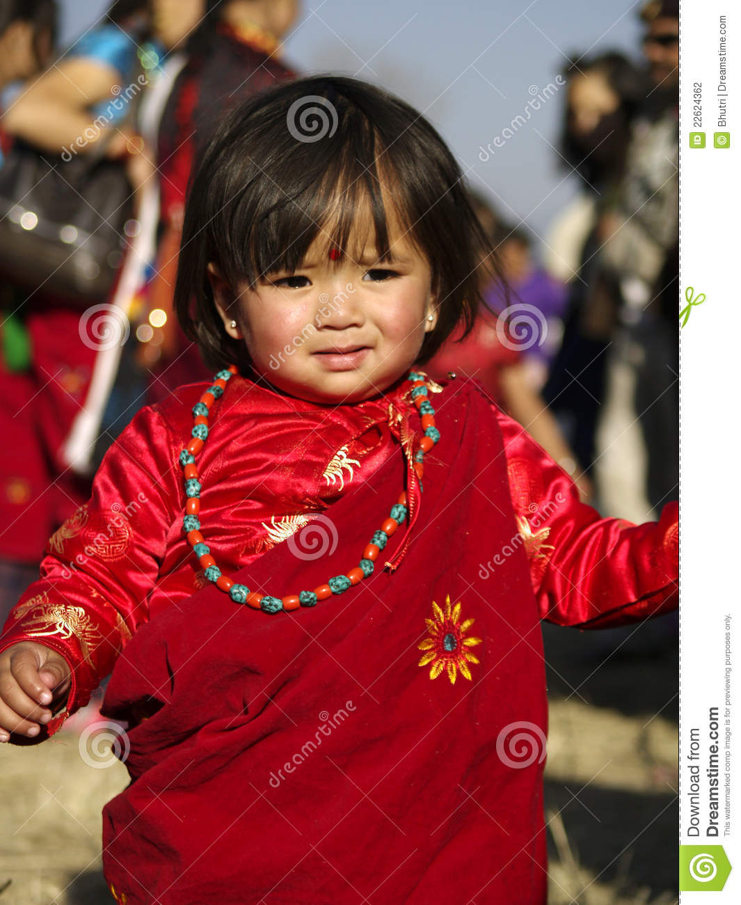 ... small gurung girl in traditional Gurung dress and ornaments