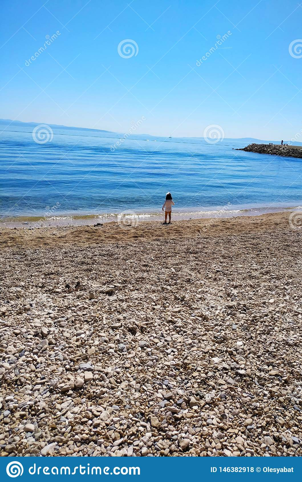 Small girl and the sea