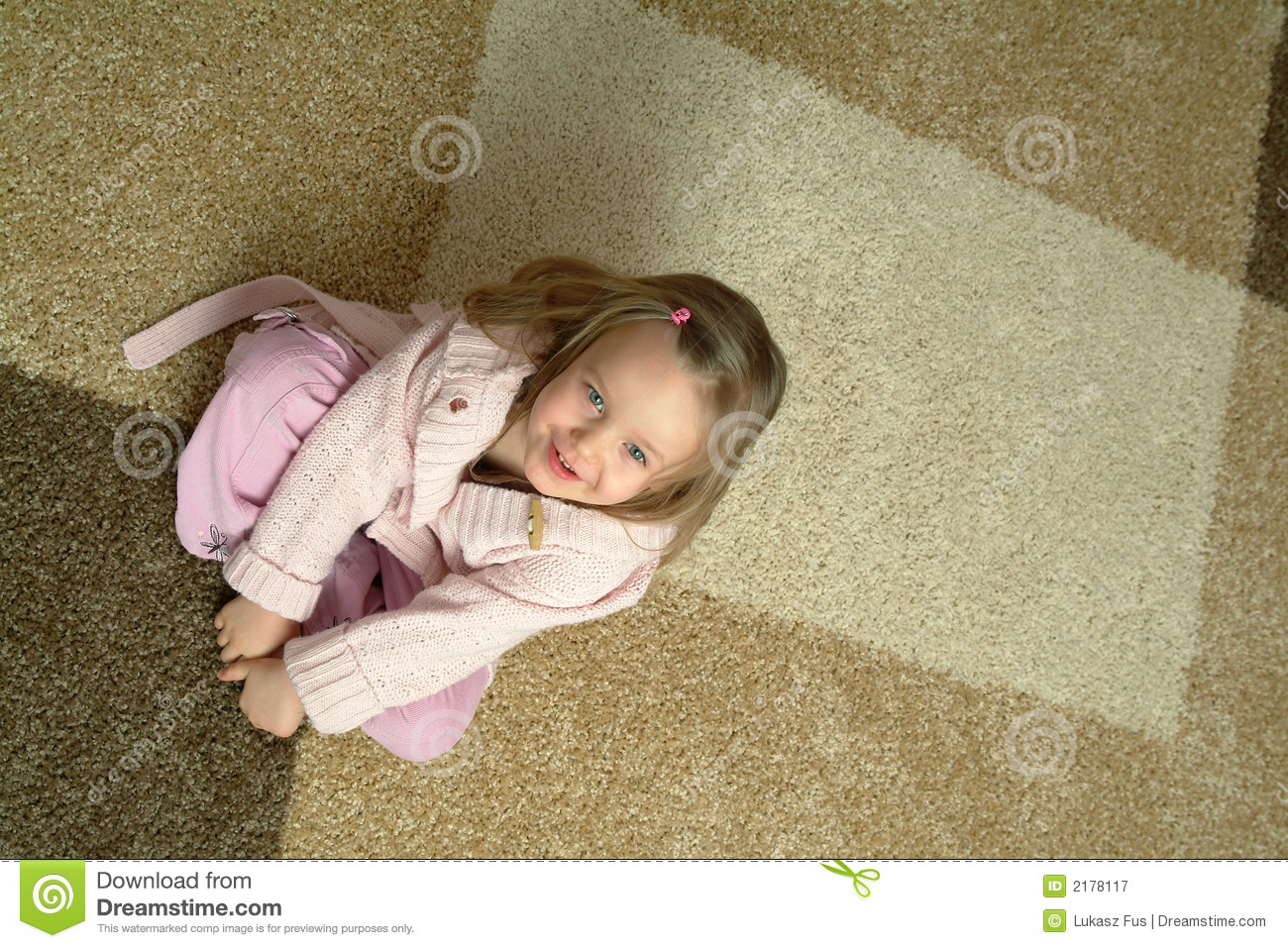 Small Girl Sitting On Carpet Royalty Free Stock