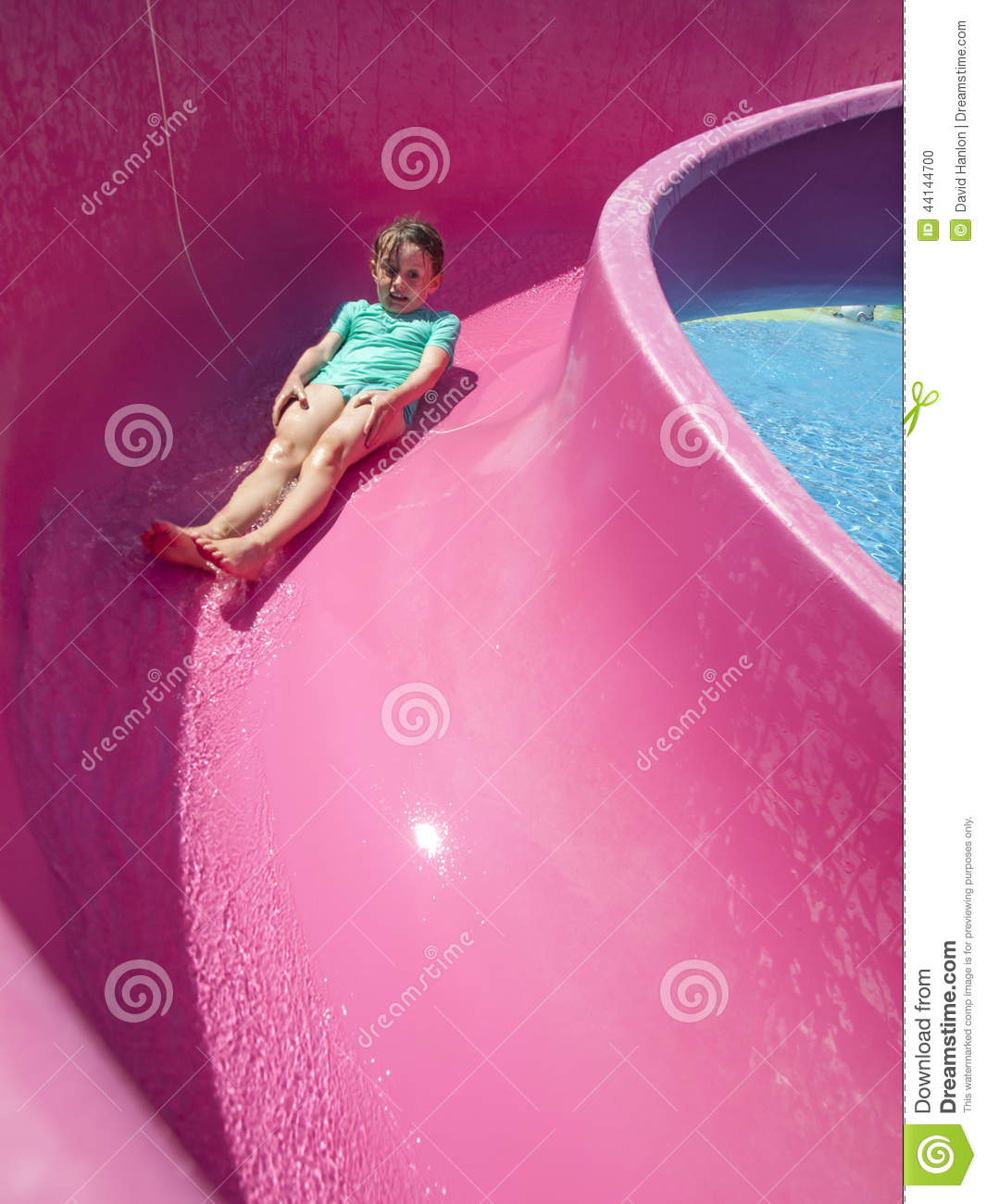 Small girl on a water slide