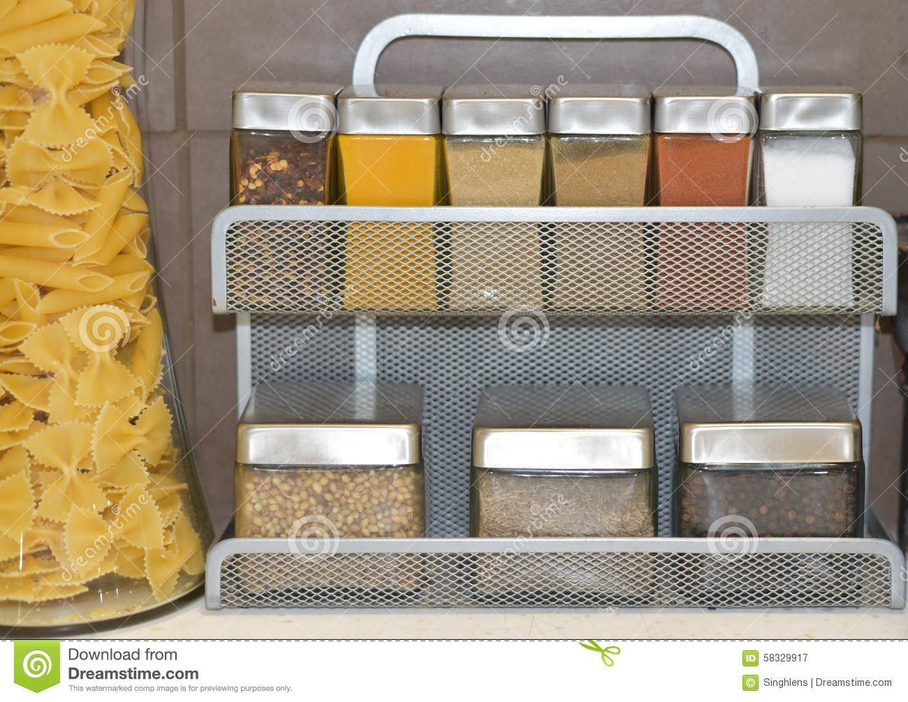small glass jars with spices and other kitchen condiments on a condiments glass jars kitchen