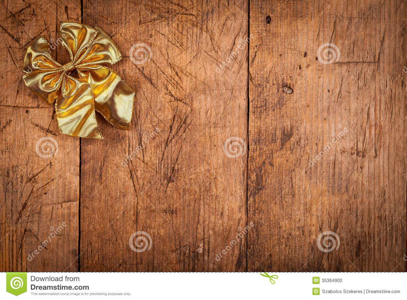 Small golden ribbon on wooden background stock photo for Rustic concept