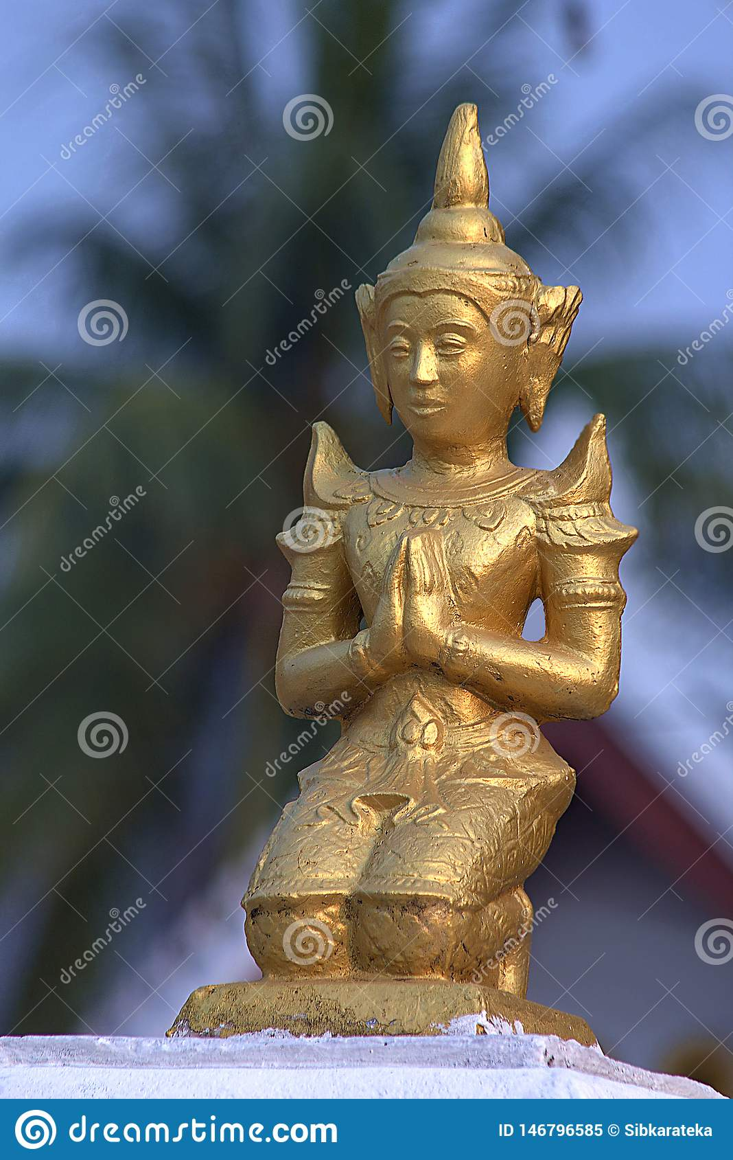 Small golden sculpture in buddhist temple