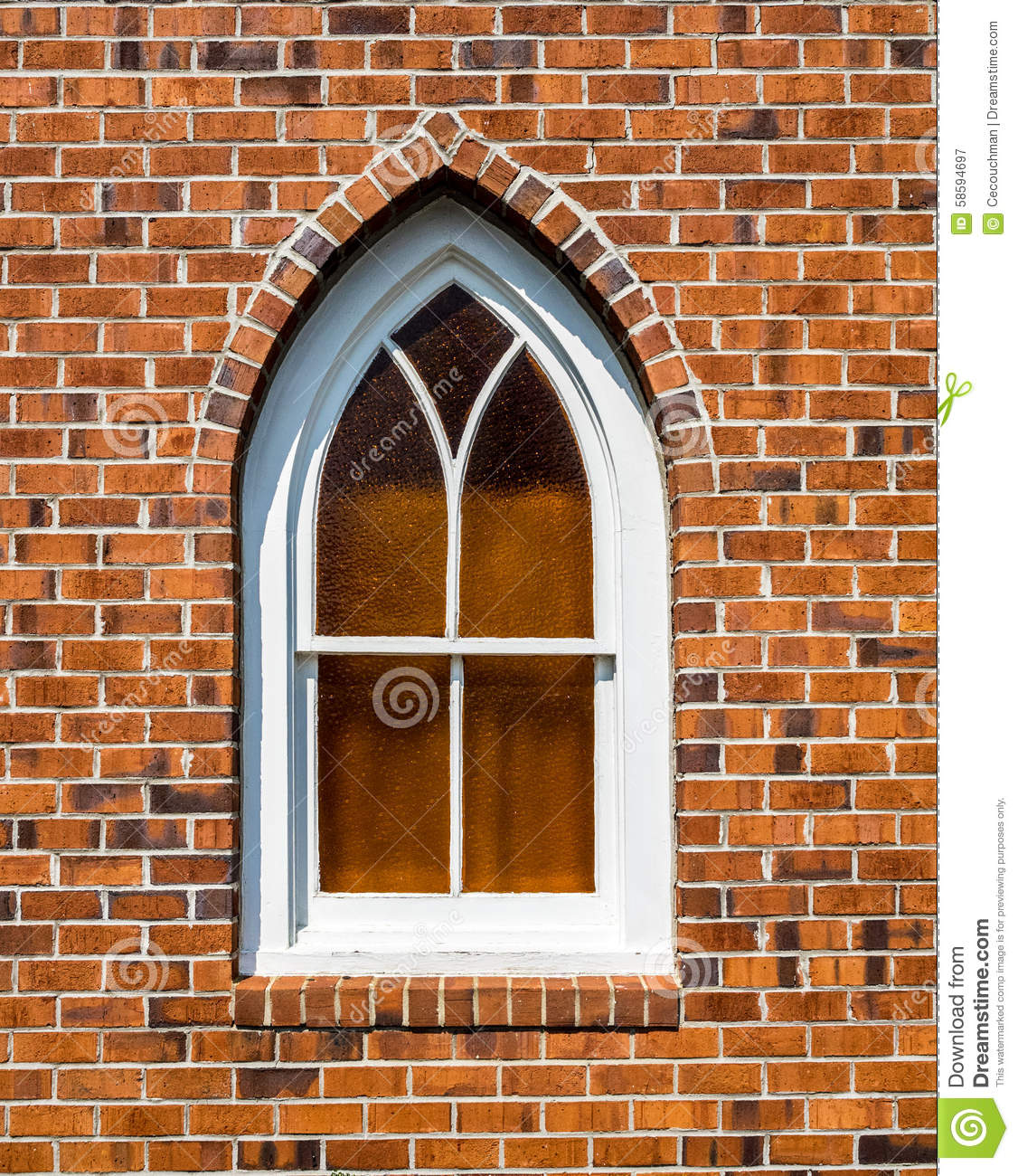 Small Gothic Window In Red Brick Wall Stock Image
