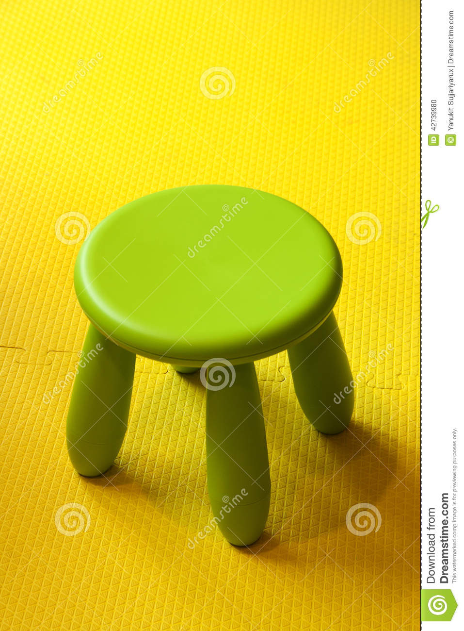 Small Yellow Plastic Chair Isolated On White Stock Photo