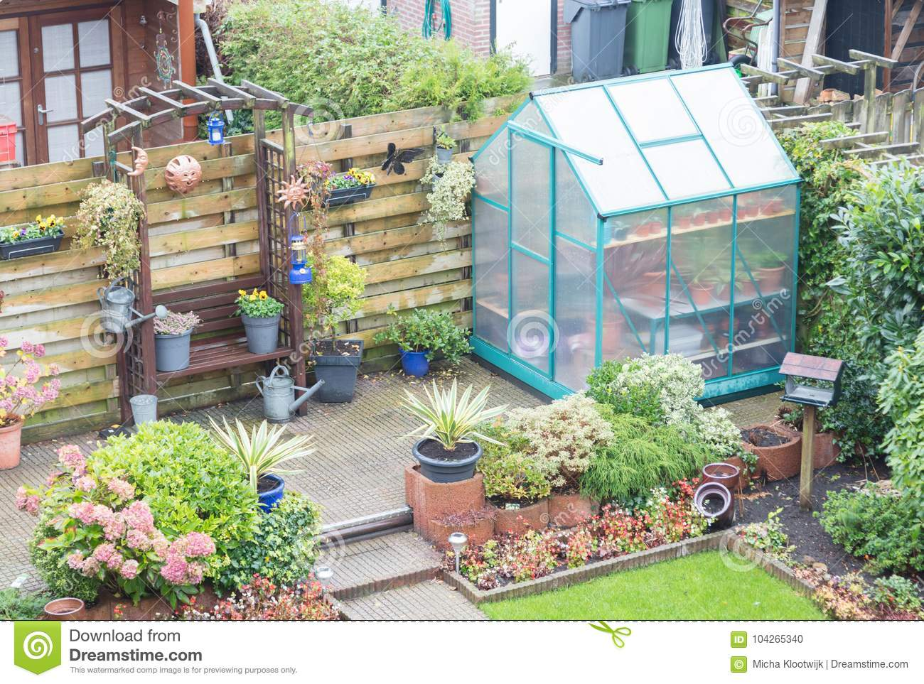 Surprising Small Greenhouse In A Garden Stock Photo Image Of Small Home Interior And Landscaping Ologienasavecom