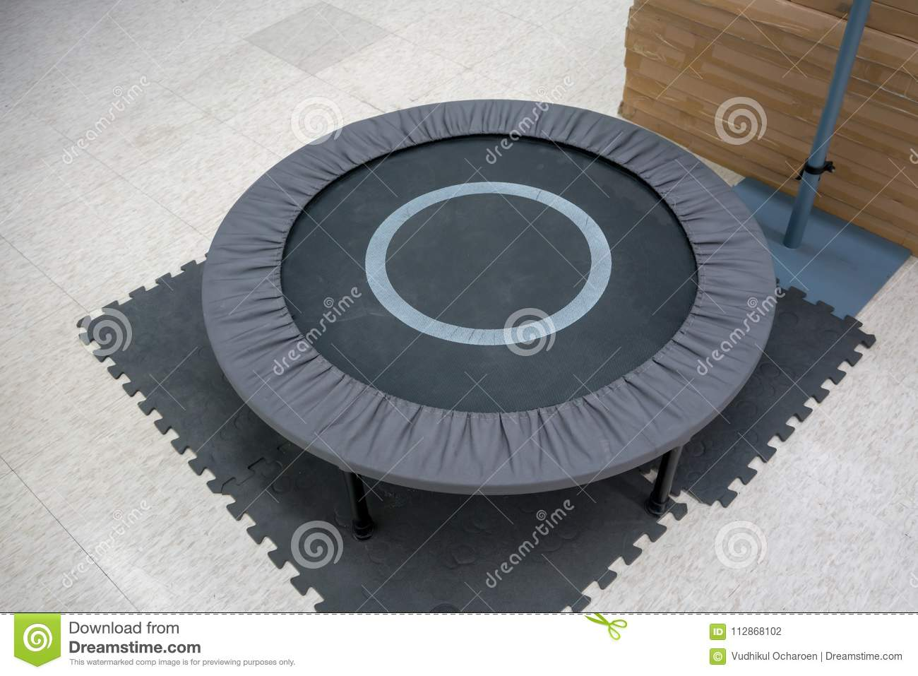 Small grey and black fitness trampolin on foam sheet