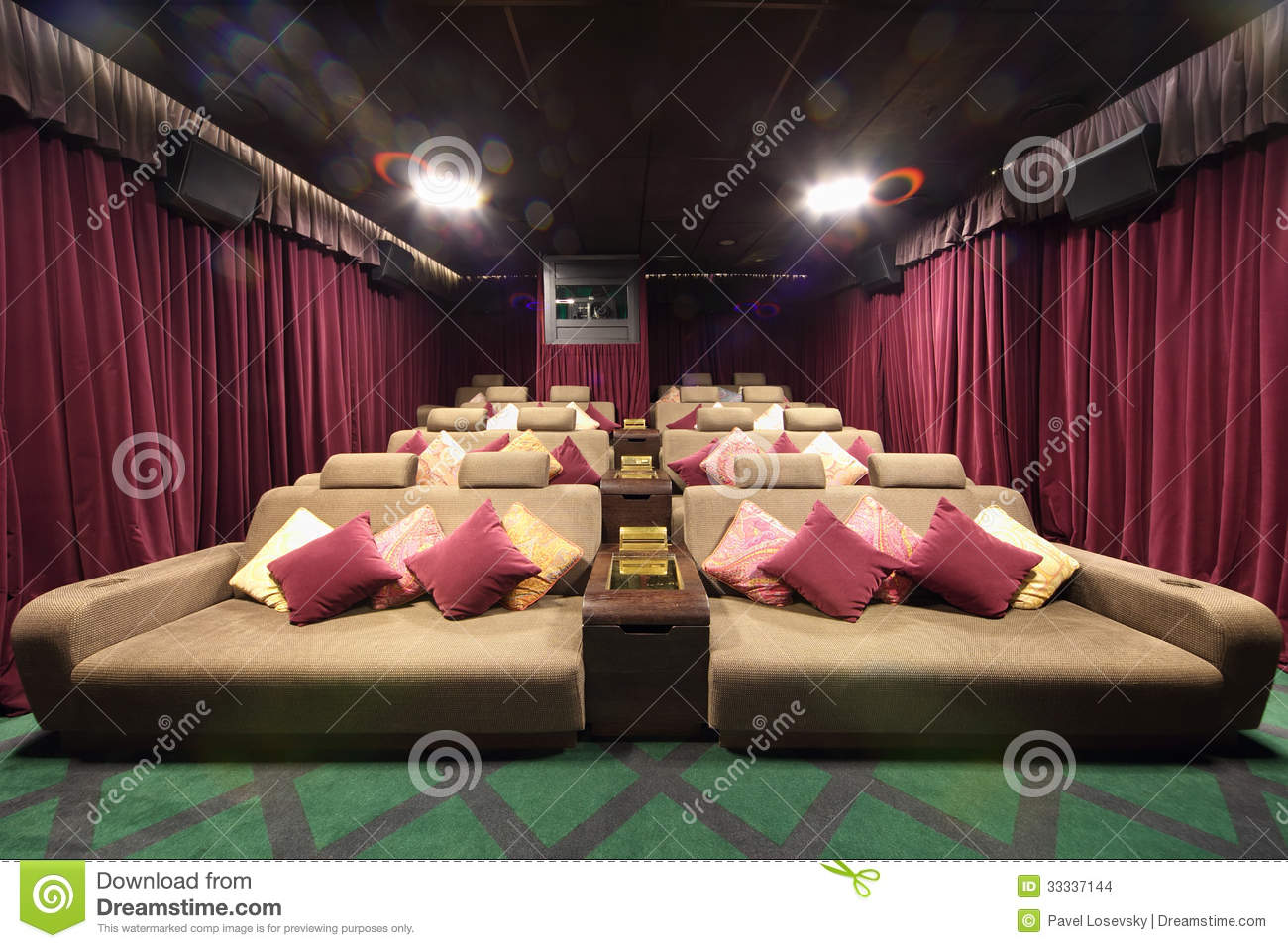 Small Hall Of Cinema With Soft Couches With Pillows Stock