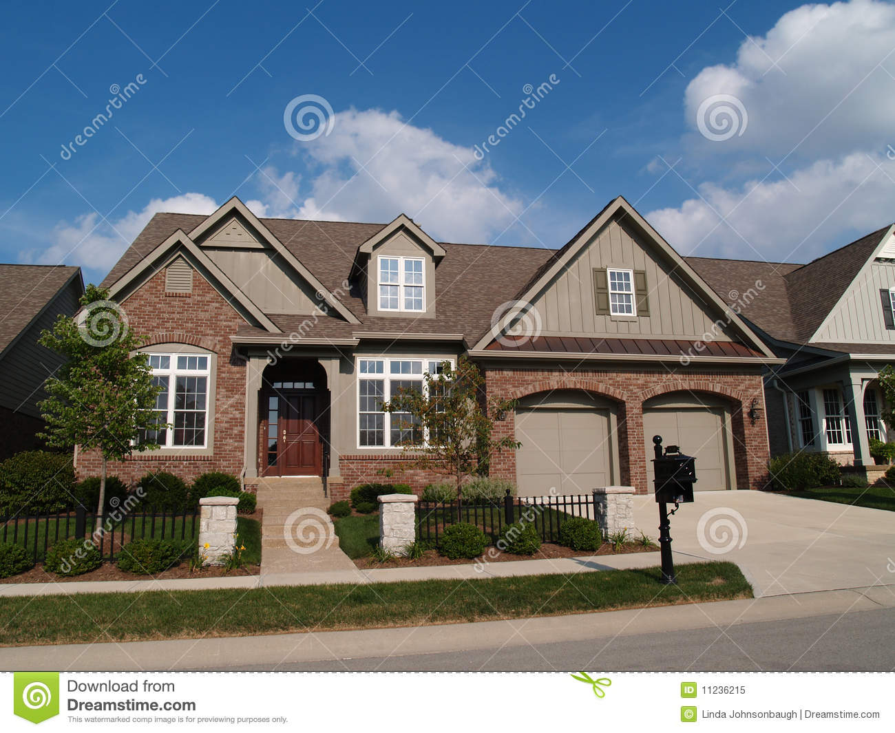Small Home With Double Garage Royalty Free Stock Photo