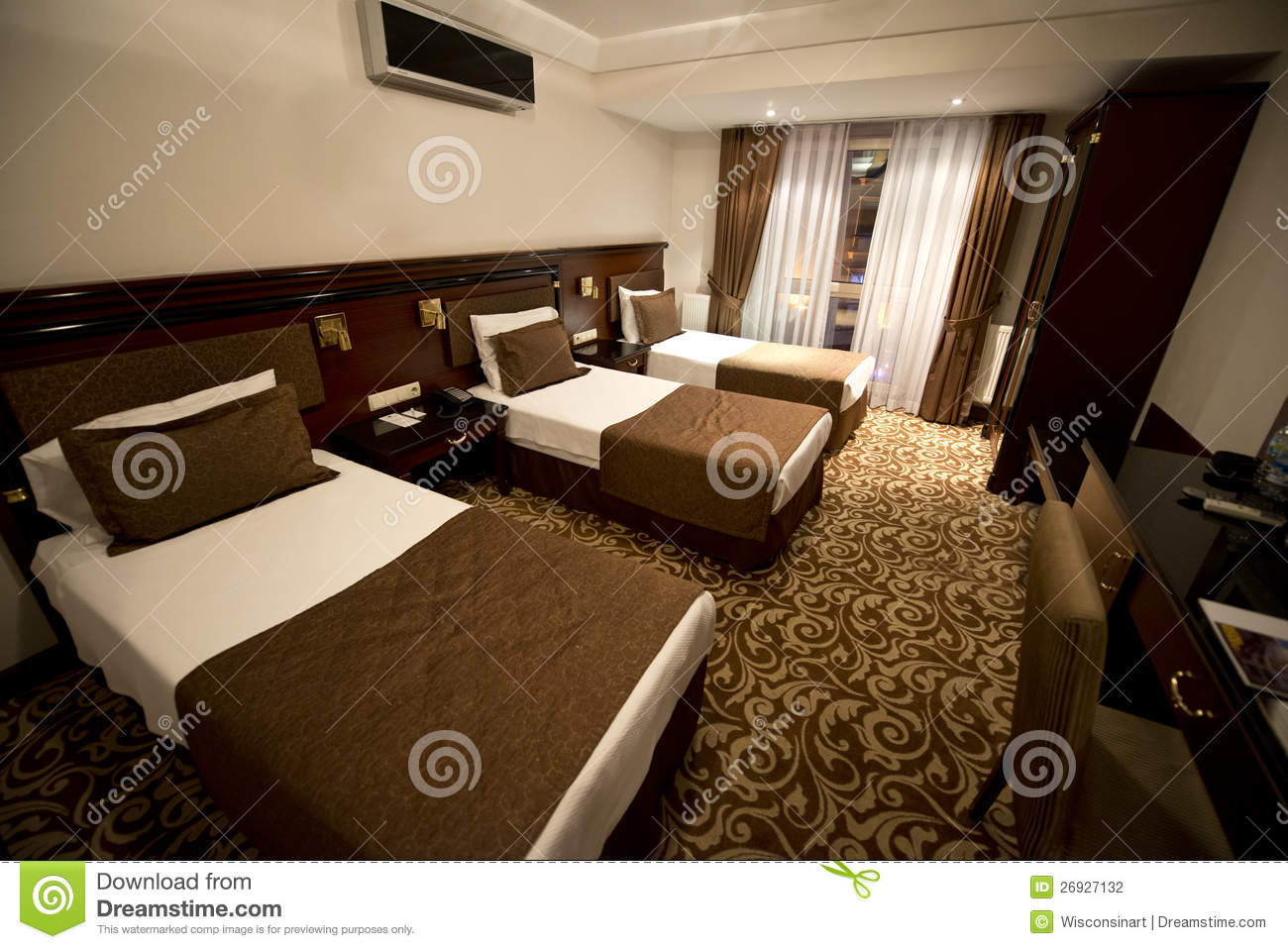 Small hotel room with three single beds stock photography for Single bed designs for small rooms
