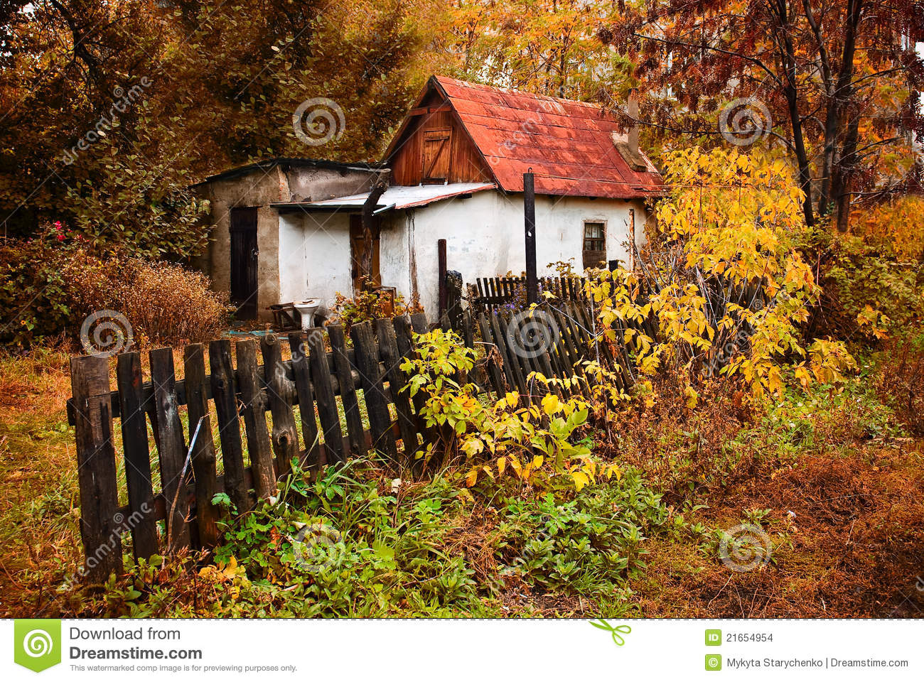 Small House In The Autumn Forest Village Stock