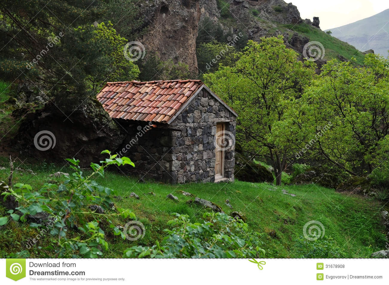 A small house in the mountains of georgia stock photo for Building a house in the mountains