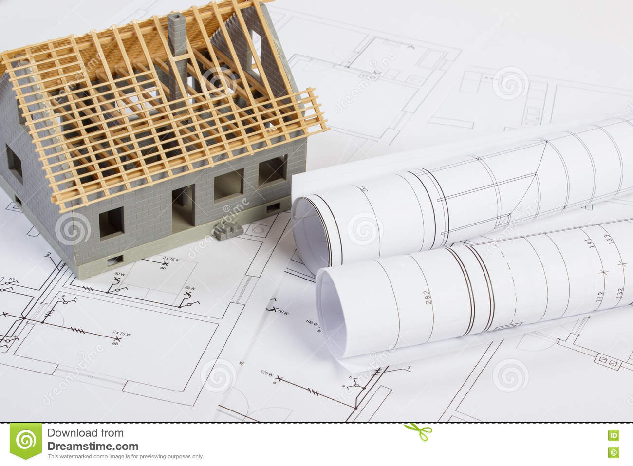 Small House Under Construction And Electrical Drawings Concept Of