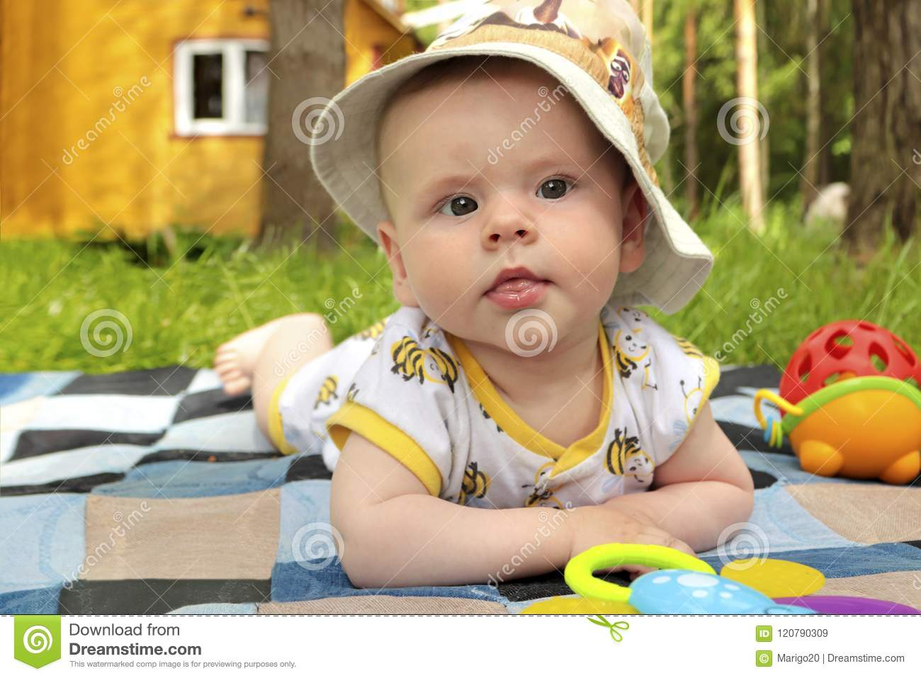 6d476e7aa73 A Small Infant In A Hat Resting In The Summer Stock Image - Image of ...