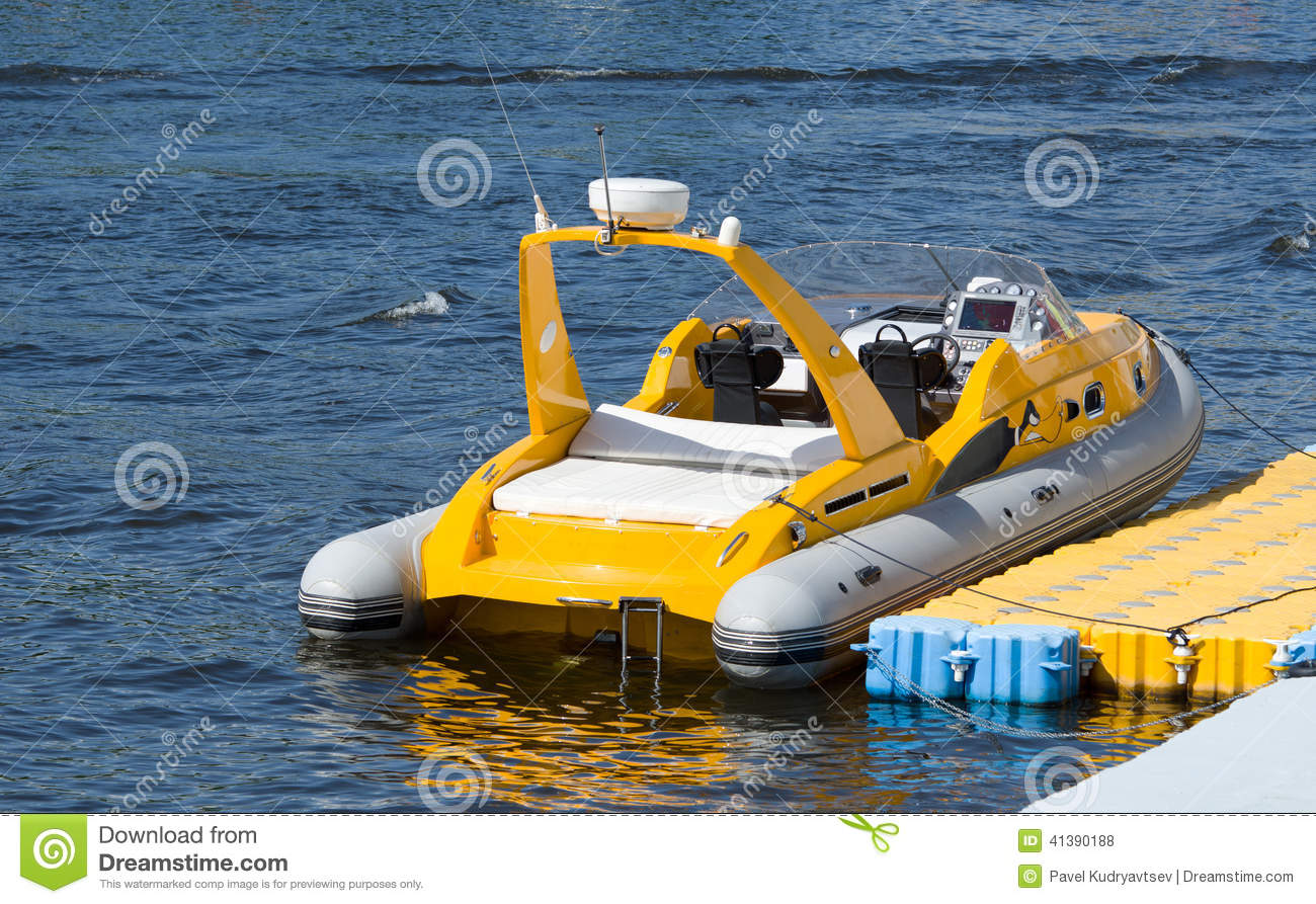 A small inflatable boat stock photo image 41390188 for Small motor boat cost