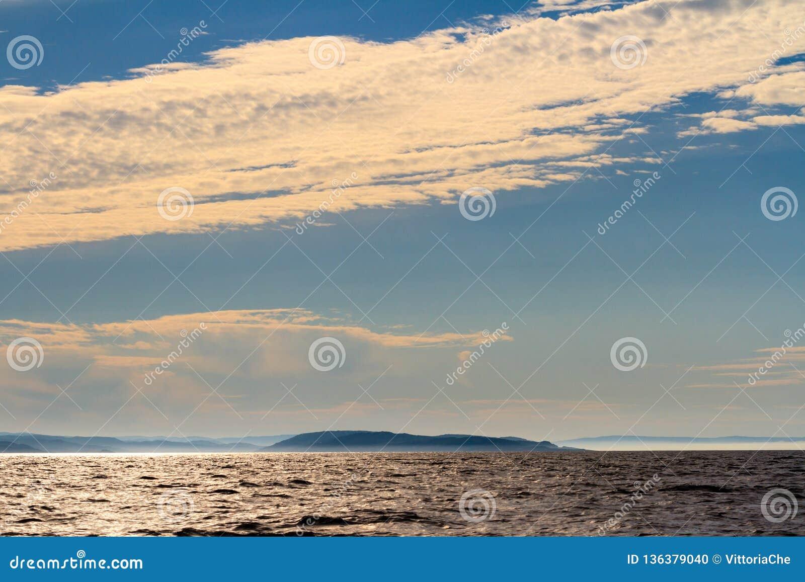 Small island in Barents sea on the sunset. Arctic ocean, Kola Peninsula, Russia