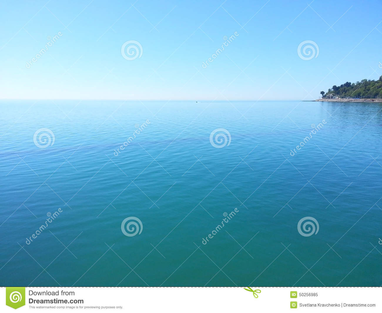 A small island in the blue water of Black Sea