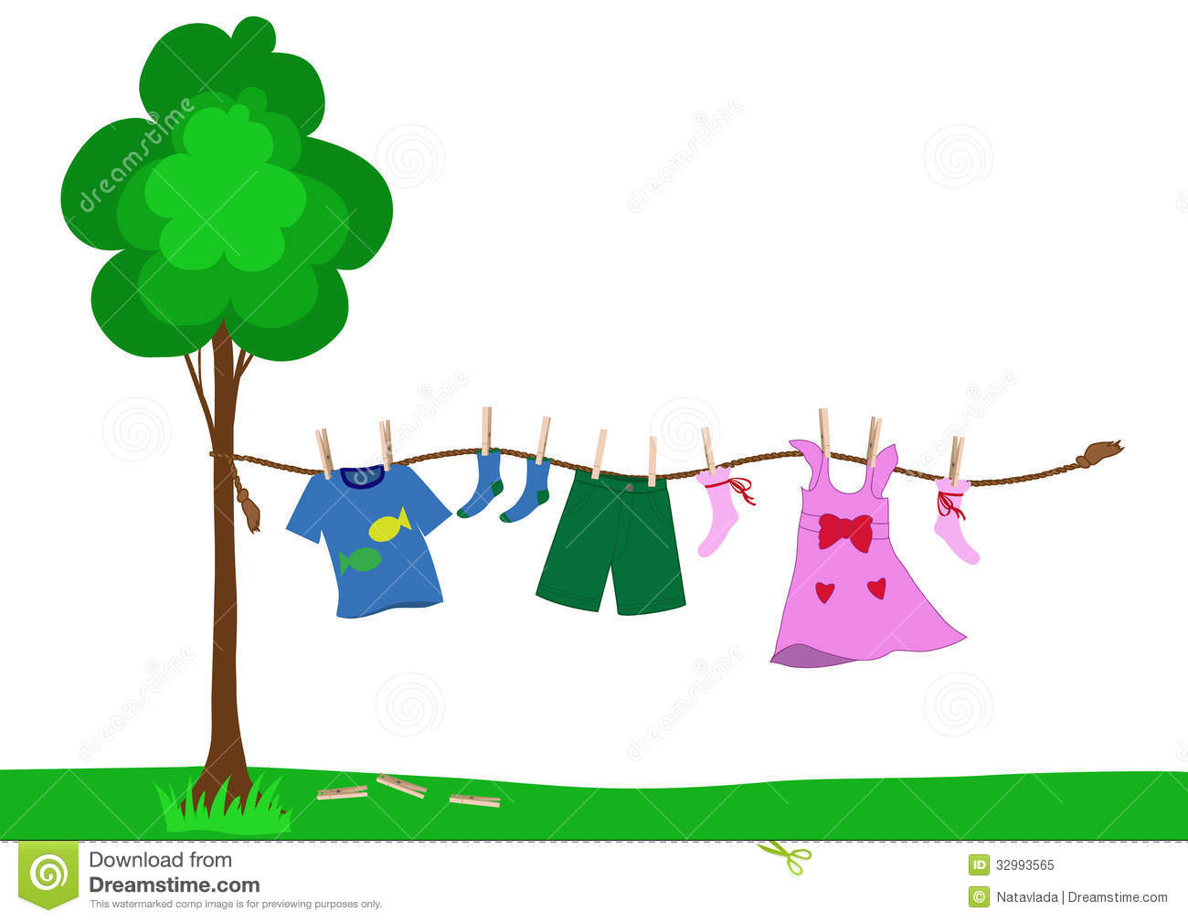 small boy and girl clothes drying pinned with clothespins to the rope