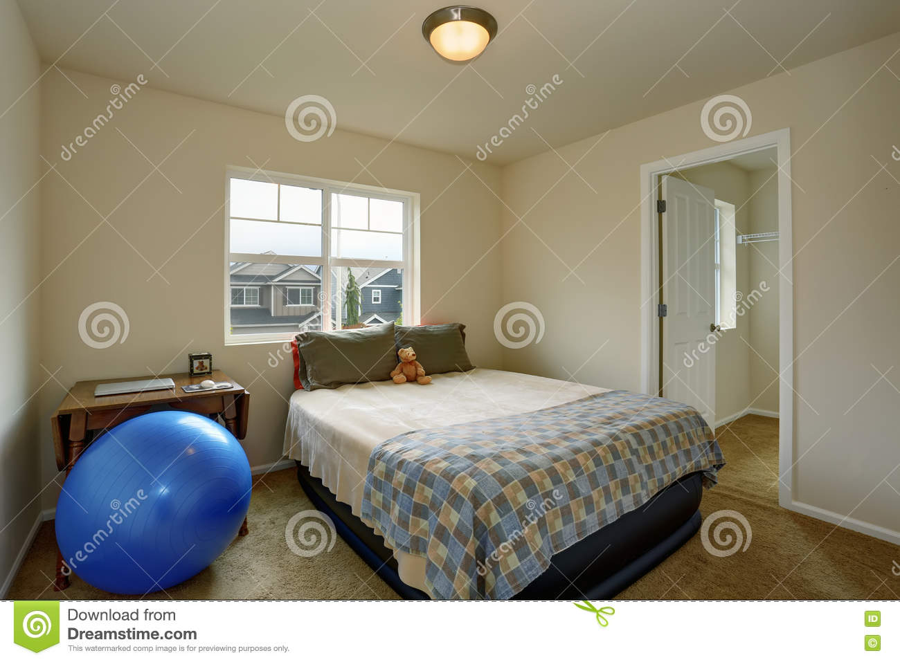 Small Kids Bedroom With Table, Blue Ball And Small Green Bed ...
