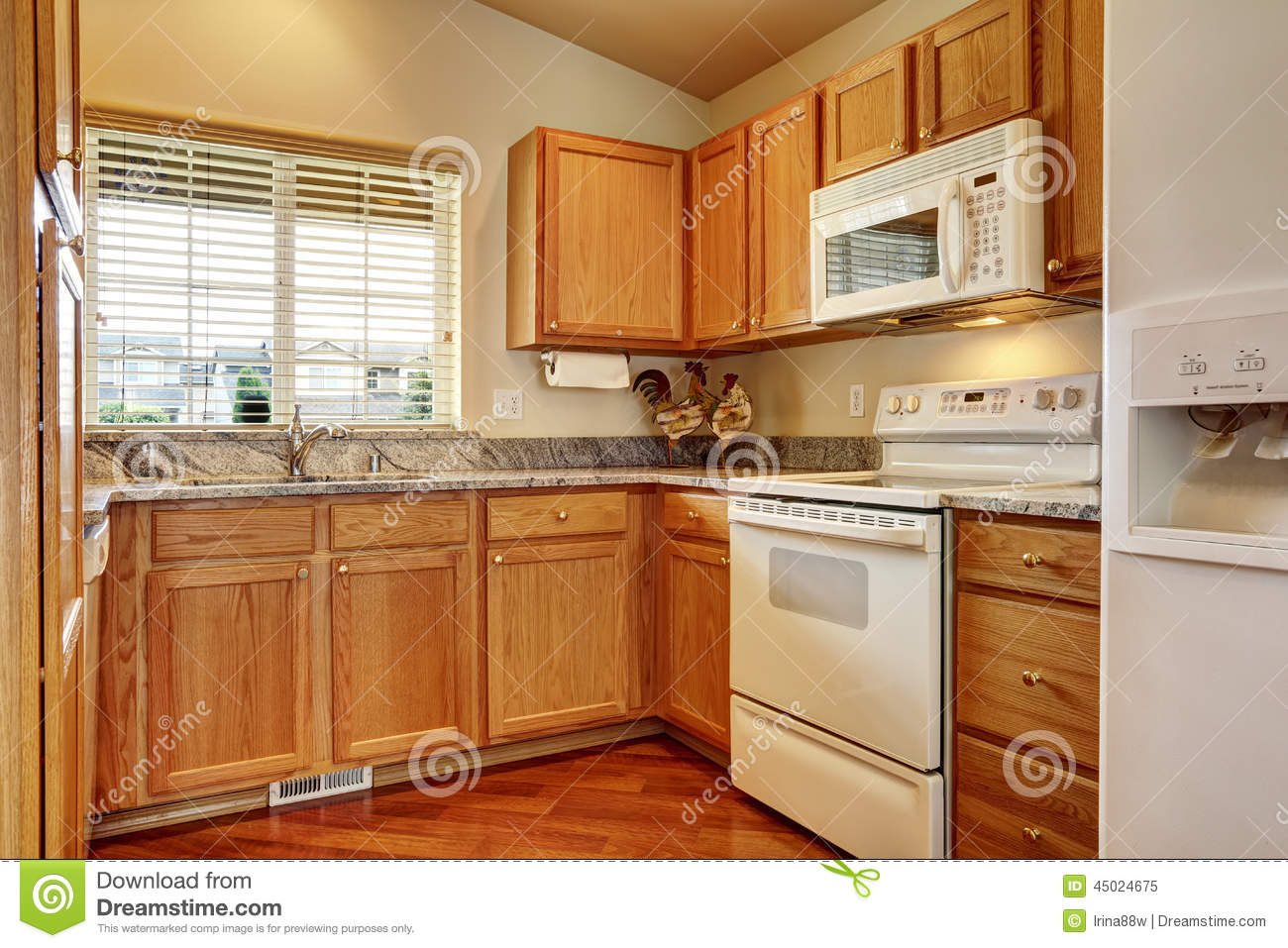 Small kitchen area with white appliances stock image for Kitchen designs that stand the test of time