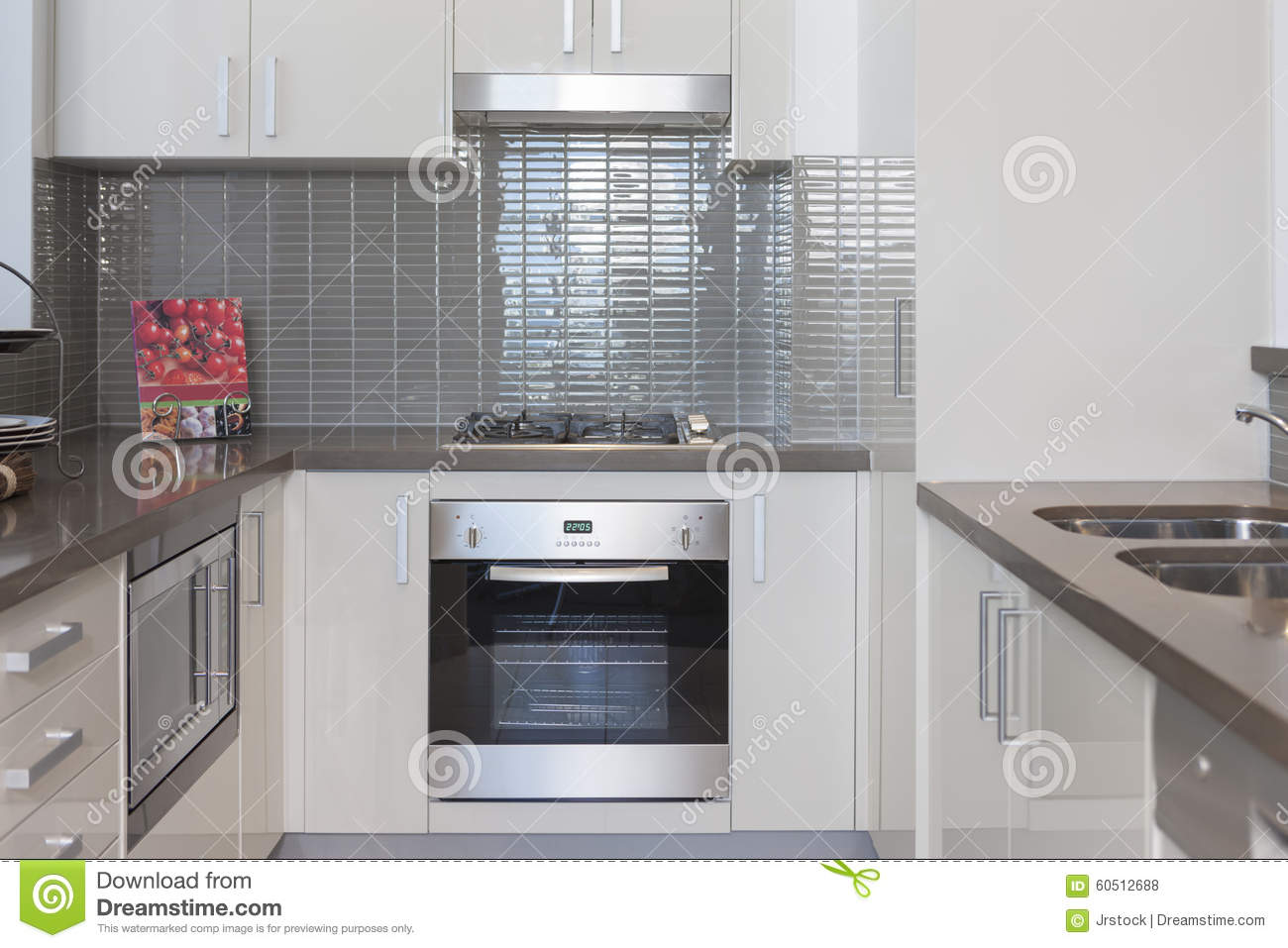 Small kitchen with built in stove stock photo image of for Small built in kitchen