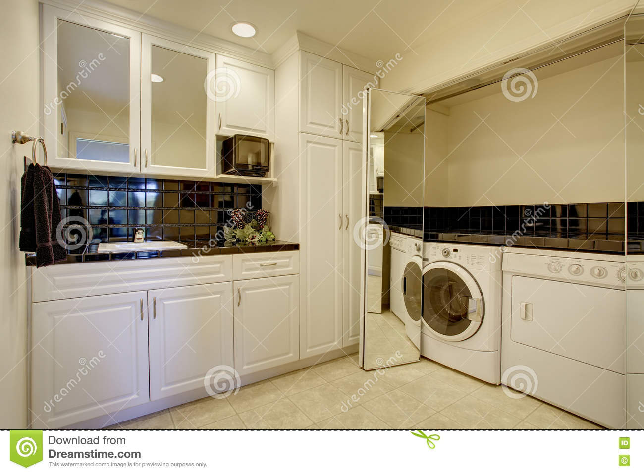 Small kitchen room with built in laundry area stock photo for Small built in kitchen