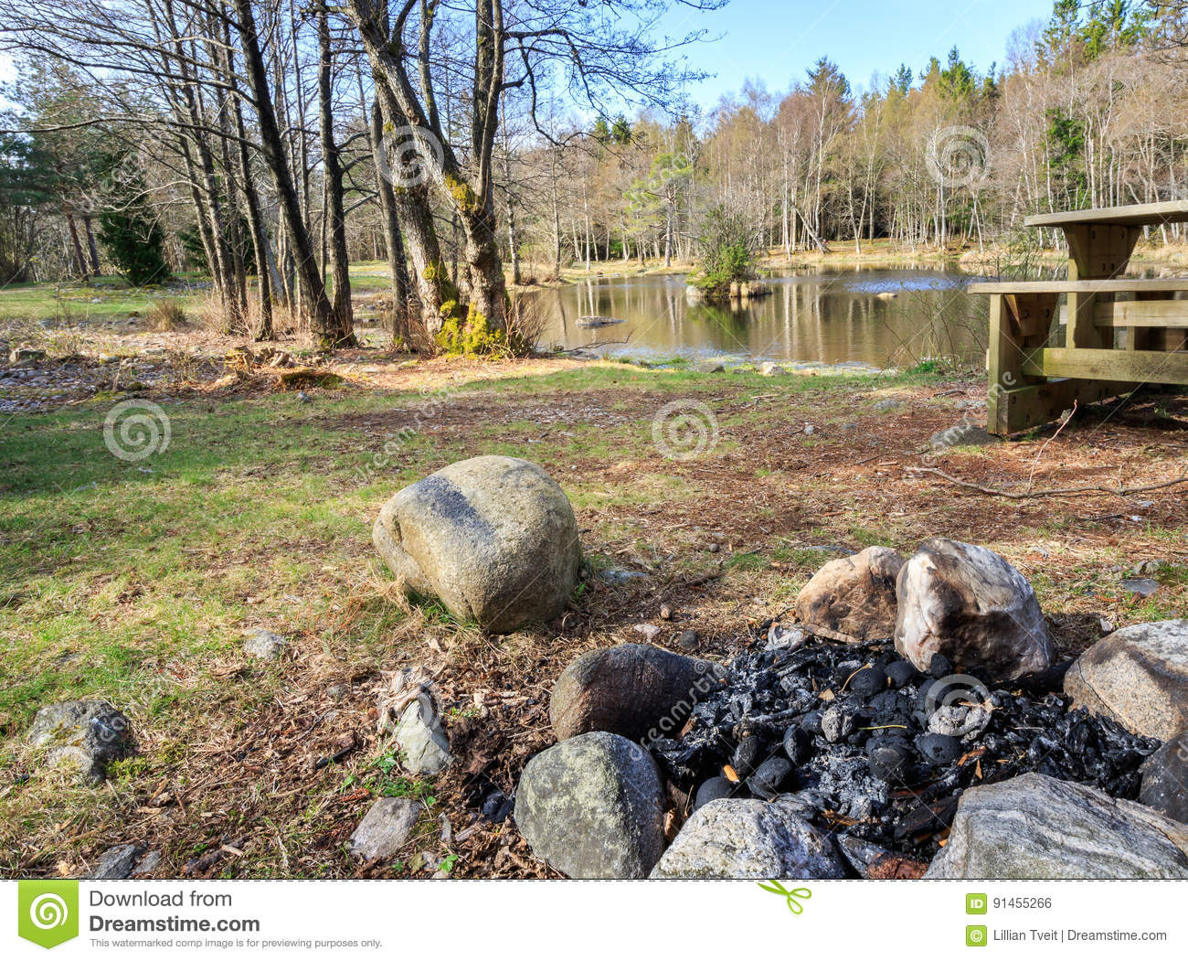 Small Lake With Campfire And Bench In Jomfruland National