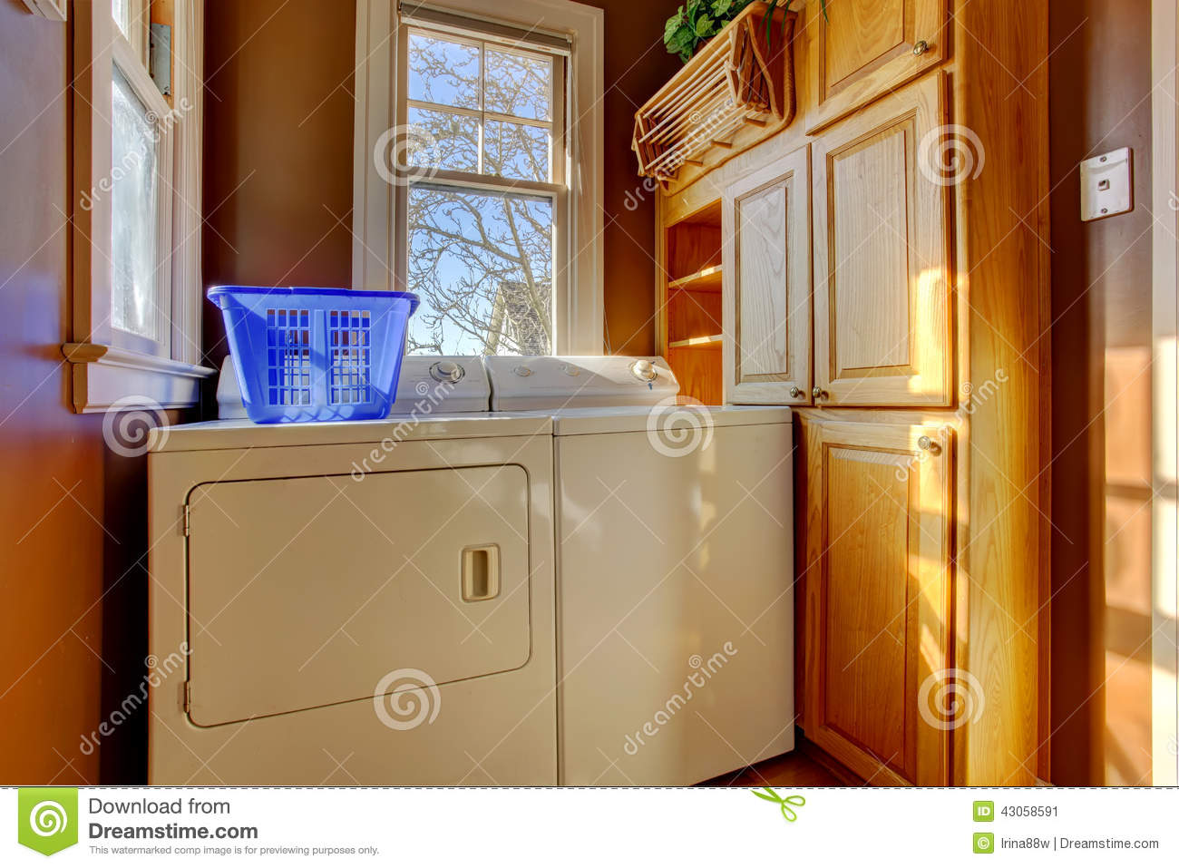 Small Laundry Room With Washer And Dryer Stock Photo
