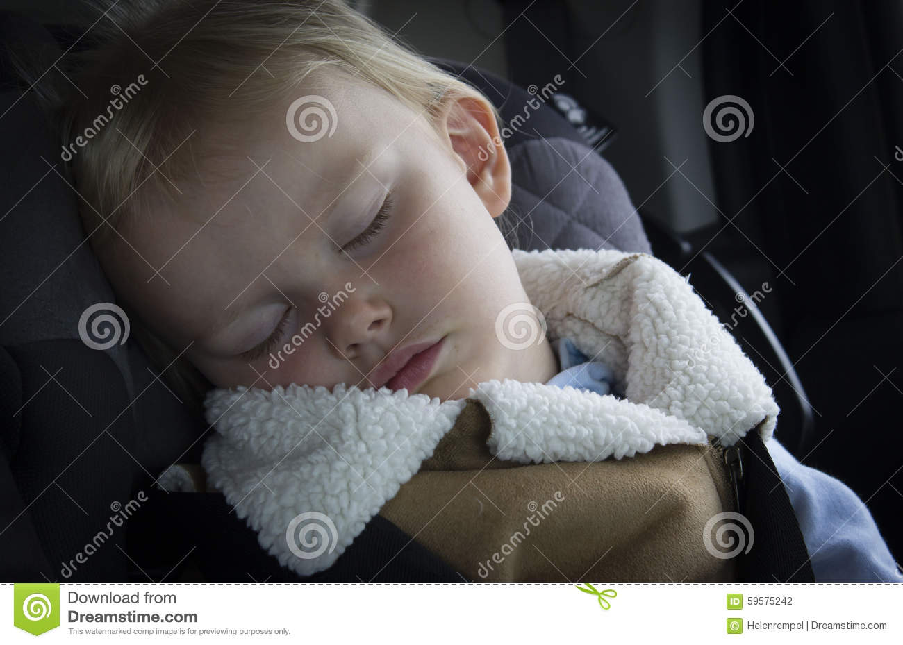 Small Little Girl Toddler Sleeping In Her Car Seat