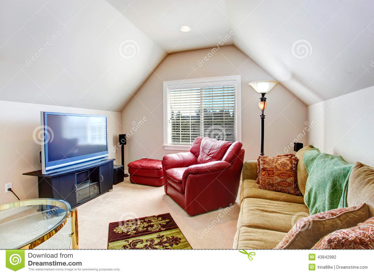 living room with vaulted ceiling furnished with bright red armchair