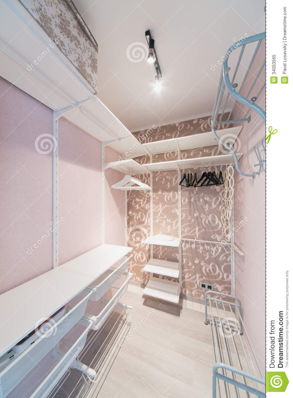 Small Modern Dressing Room Made In Pink With Hangers Stock