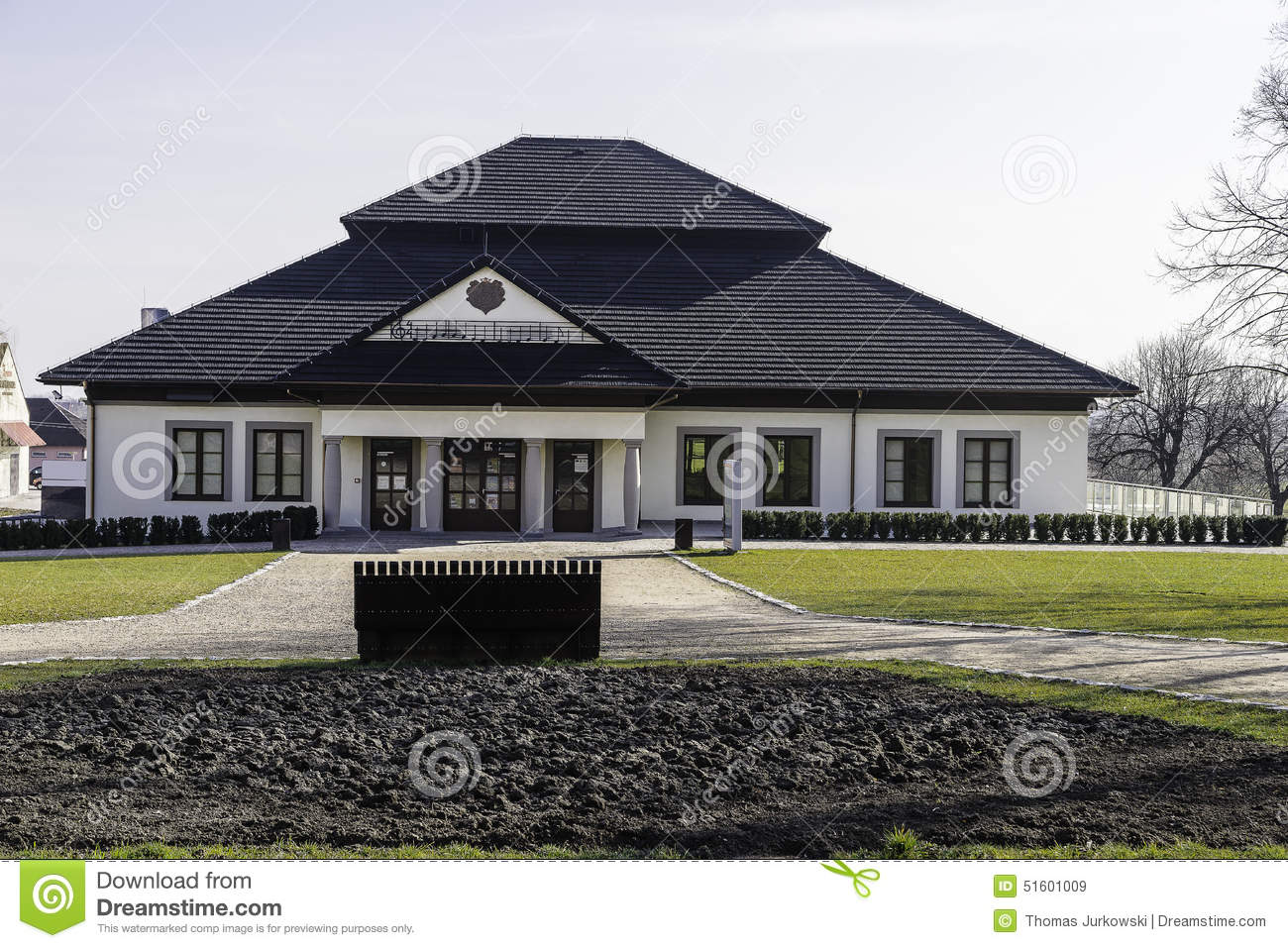 Small Office Building. Exterior Of A Small One Story Office Building In  Niepolomice ,